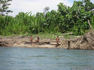 Mashco-Prio Indians on a riverbank