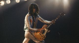 Jimmy Page performs with Led Zeppelin