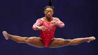 Simone Biles competes on the balance beam during the Women's competition of the 2021 U.S. Gymnastics Olympic Trials at America's Center on June 27, 2021 in St Louis, Missouri.