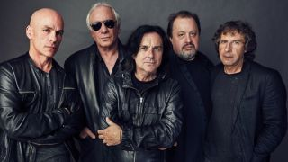 Marillion standing together, looking at the camera.