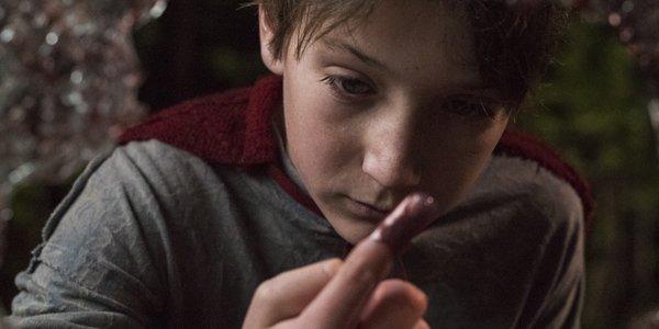 Jackson Dunn as Brandon Breyer looking at his bloody finger in Brightburn