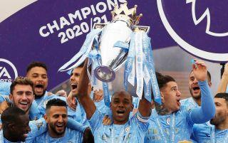 Fernandinho lifts the Premier League trophy for Manchester City
