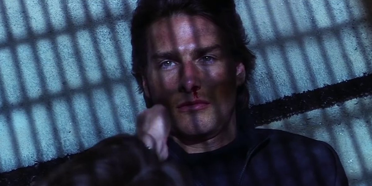 Tom Cruise as Ethan Hunt, about to be revealed to be Richard Roxburgh as Hugh Stamp in Mission: Impo