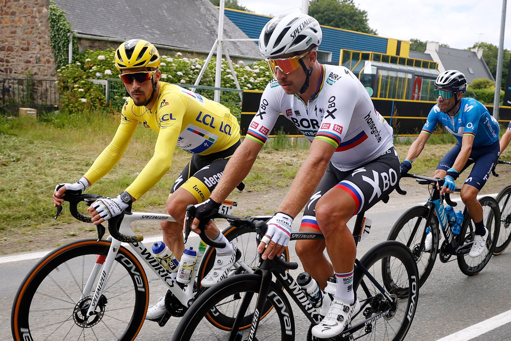 MRDEBRETAGNE GUERLDAN FRANCE JUNE 27 Julian Alaphilippe of France and Team Deceuninck QuickStep yellow leader jersey Peter Sagan of Slovakia and Team BORA Hansgrohe during the 108th Tour de France 2021 Stage 2 a 1835km stage from PerrosGuirec to MrdeBretagne Guerldan 293m LeTour TDF2021 on June 27 2021 in MrdeBretagne Guerldan France Photo by Chris GraythenGetty Images