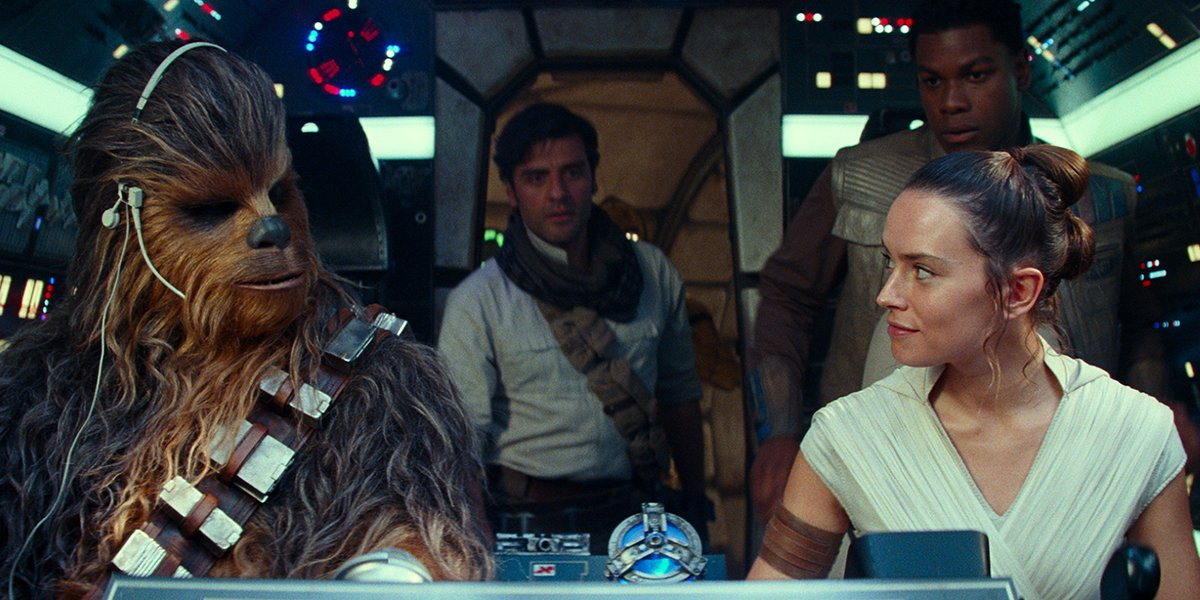 Chewie, Rey, Finn and Poe in the cockpit of the Millennium Falcon