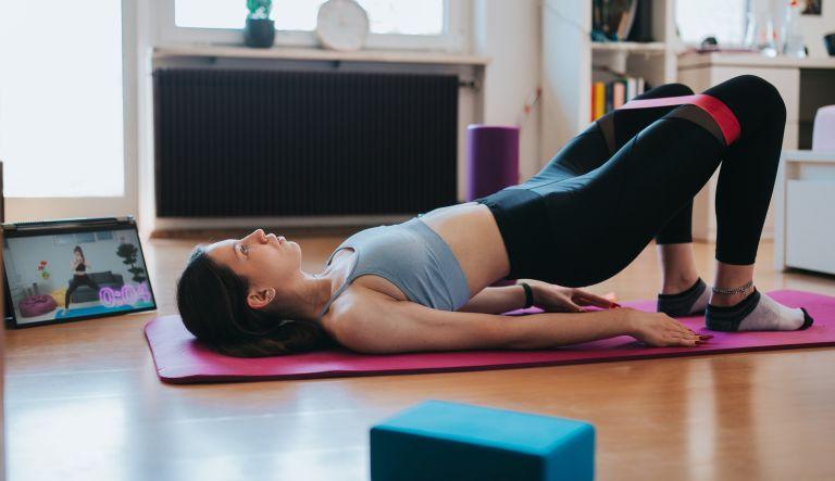Woman doing Resistance band butt workout