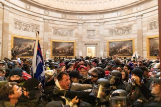 Police officers intervene after Trump supporters breached security and entered the Capitol building in Washington, on Jan. 6, 2021.