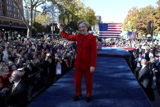 Democratic presidential candidate Hillary Clinton greets supporters on Nov. 7, 2016, wearing her signature pantsuit.