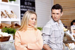 A woman avoiding a man's gaze