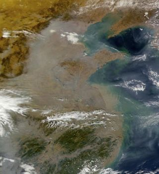 Pollution over China creates gray haze.
