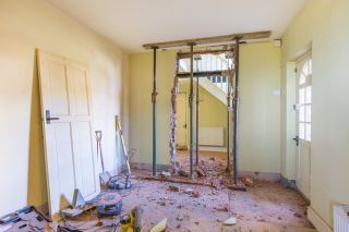 knocking down a wall to create new doorway