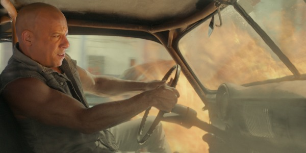 Vin Diesel driving a car on fire