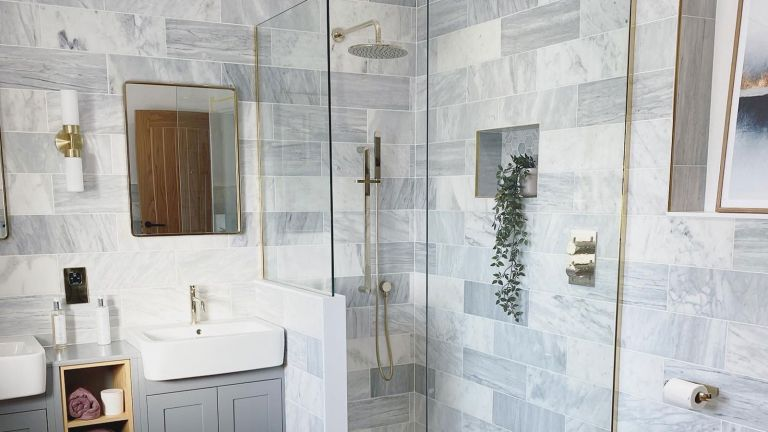grey tiled shower in bathroom