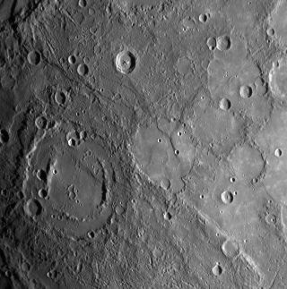 The double-ringed crater on Mercury pictured in the lower left of this image appears to be filled with smooth plains material, perhaps volcanic in nature. The Messenger spacecraft took this image during its closest approach to Mercury on Jan. 14, 2008 usi