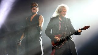 Adam Lambert and Brian May onstage in London last year