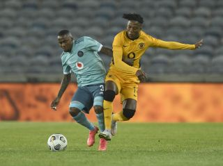 Kgaogelo Sekgota challenged by Thembinkosi Lorch