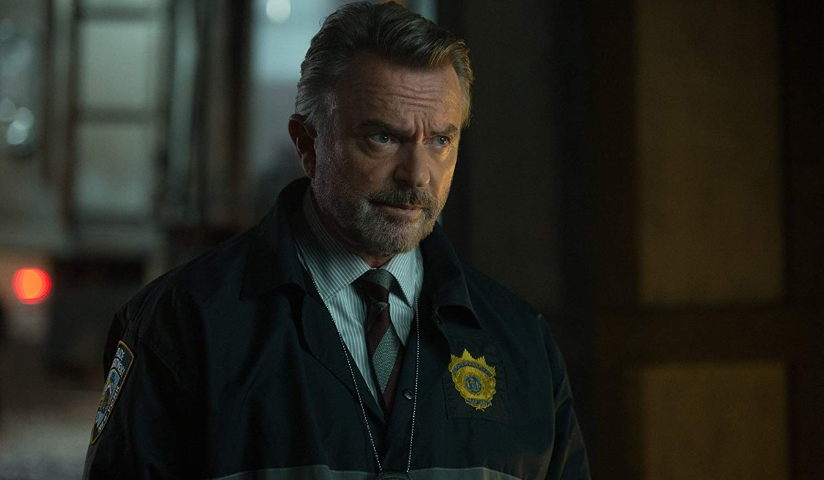 The Commuter Sam Neill looking concerned in his police windbreaker