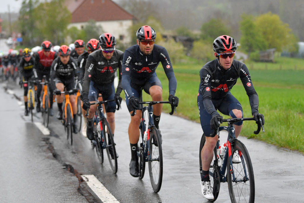 ESTAVAYER SWITZERLAND APRIL 30 Filippo Ganna of Italy Eddie Dunbar of Ireland and Team INEOS Grenadiers lead The Peloton during the 74th Tour De Romandie 2021 Stage 3 a 1687km stage from Estavayer to Estavayer Rain TDR2021 TDRnonstop UCIworldtour on April 30 2021 in Estavayer Switzerland Photo by Luc ClaessenGetty Images