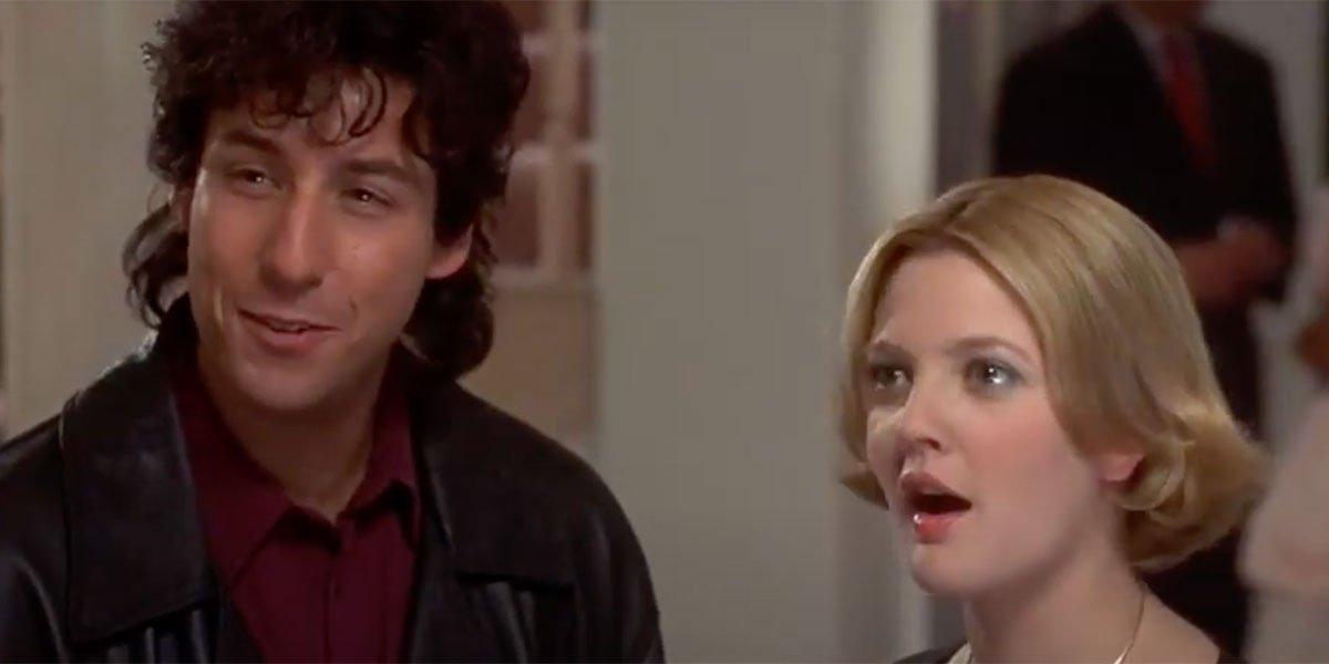 Drew Barrymore looking shocked and Adam Sandler joking in The Wedding Singer.