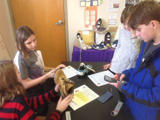 Kids examine shoes