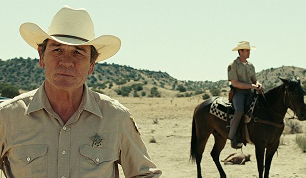 Tommy Lee Jones as Ed Tom Bell investigating the shootout in No Country For Old Men