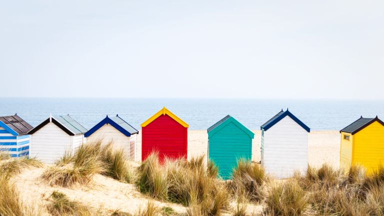 Best UK staycations: beach huts on a clear day