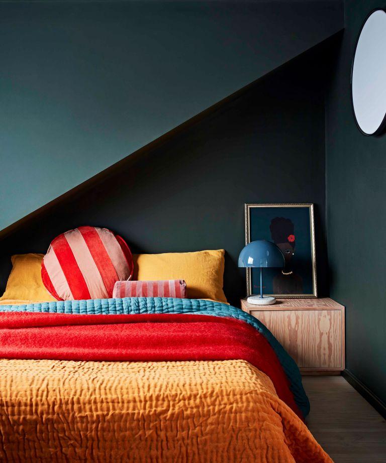 bedroom tv ideas dark green bedroom with colourful bedlinen