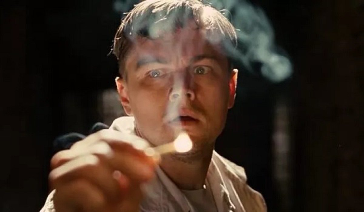 Shutter Island Leonardo DiCaprio lights a match with a horrified face