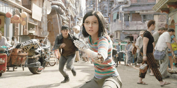 Alita: Battle Angel Alita takes a fighting stance on a sunny Iron City day