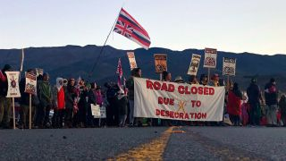 Demonstrators block the Maunakea Access Road on July 15, 2019, to oppose the construction of the Thirty Meter Telescope.