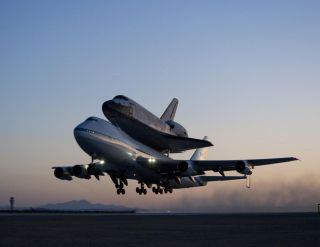 Shuttle Discovery Begins Ferry Flight to Florida