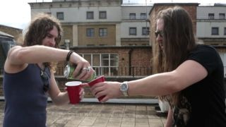 Airbourne sharing drinks