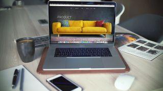 macbook open on website on desk