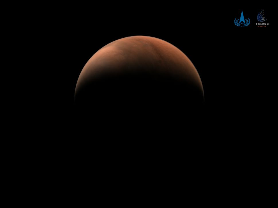 China's Tianwen-1 spacecraft captures stunning crescent Mars photos