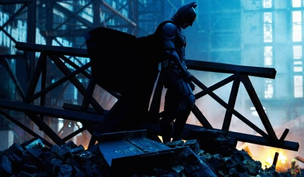 The Dark Knight Christian Bale Batman stands in the rubble