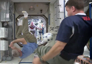 Astronaut Steve Swanson performs a bicycle kick on the International Space Station