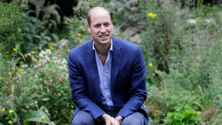 Prince William, Duke of Cambridge socially distances as he speaks with service users during a visit to the Garden House of the Light Project in Peterborough