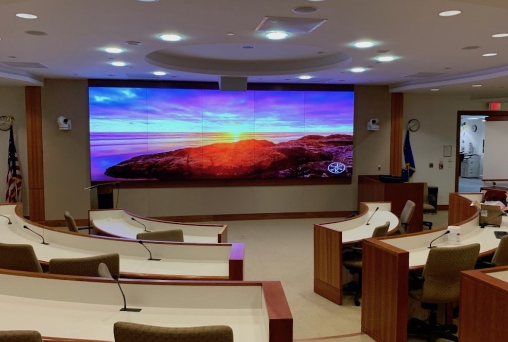 MITRE's auditorium in Bedford, MA, with AV integration by HB Communications.