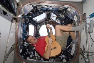 Astronaut Hadfield Plays Guitar Aboard ISS