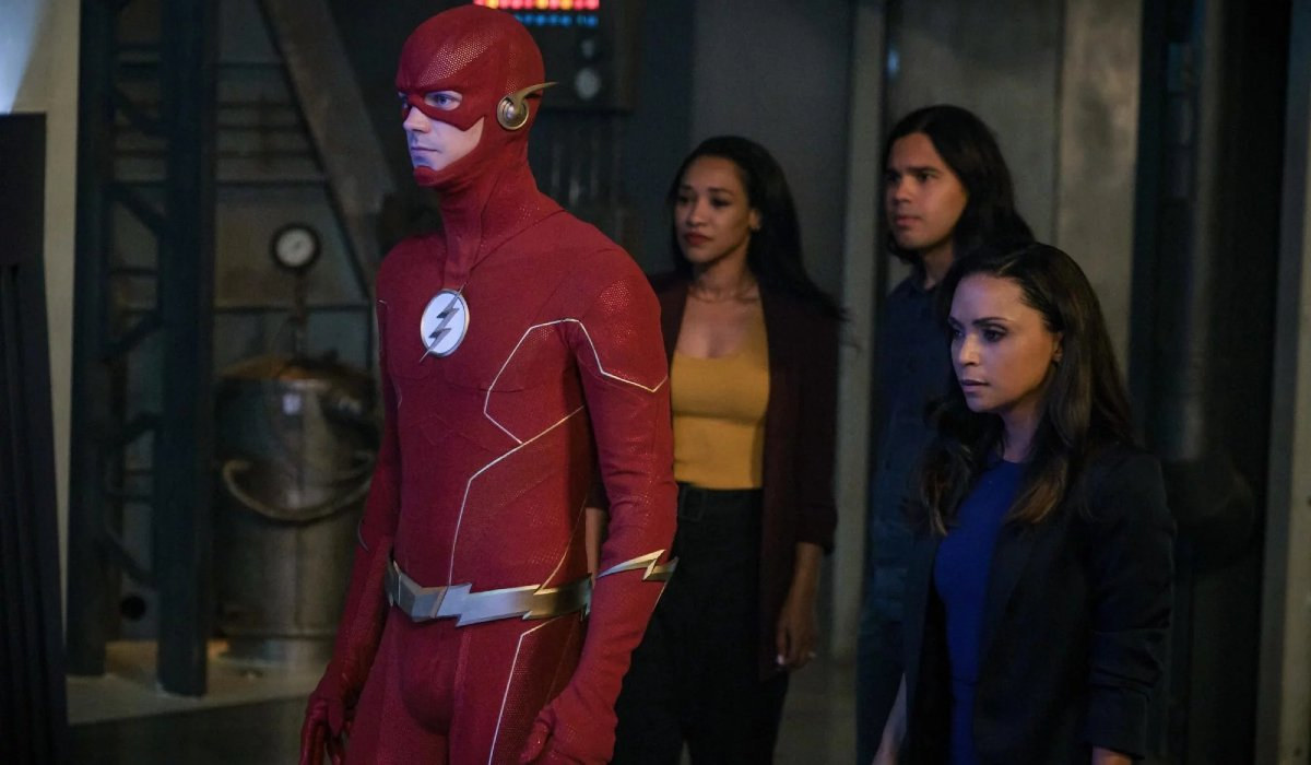 The Flash and his friends stand together in a lab