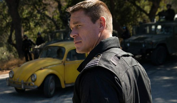 Bumblebee John Cena giving a slight smirk in front of the VW Beetle