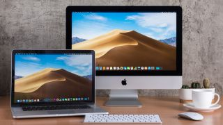 Apple MacBook and Apple iMac on a desk in home office