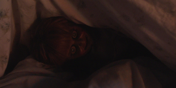 Annabelle under the sheets in Annabelle Comes Home