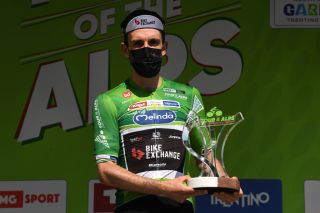 RIVA DEL GARDA ITALY APRIL 23 Simon Yates of United Kingdom and Team BikeExchange Green Leader Jersey celebrates at final podium during the 44th Tour of the Alps 2021 Stage 5 a 1209km stage from Valle del Chiese Idroland to Riva del Garda Trophy Mask Covid Safety Measures TourofTheAlps TouroftheAlps on April 23 2021 in Riva del Garda Italy Photo by Tim de WaeleGetty Images