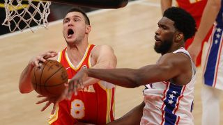 Joel Embiid #21 of the Philadelphia 76ers strips the ball from Danilo Gallinari #8 of the Atlanta Hawks during the second half of game 3 of the Eastern Conference Semifinals at State Farm Arena on June 11, 2021 in Atlanta, Georgia.