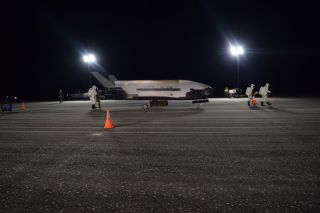 A U.S. Air Force X-37B space plane, an unpiloted miniature space shuttle, is seen after landing at NASA's Kennedy Space Center Shuttle Landing Facility on Oct. 27, 2019 to end its record 780-day OTV-5 mission.
