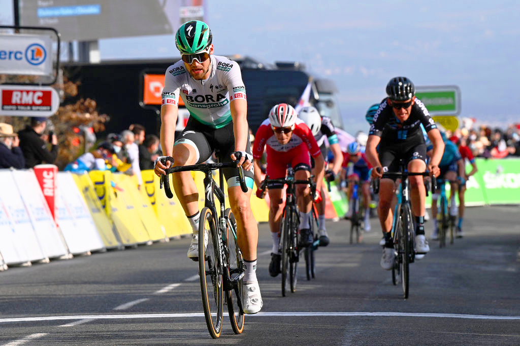 Max Schachamann (Bora-Hansgrohe) leads Guillaume Martin (Cofidis) and Tiesj Benoot (Team DSM) over the line on stage 4 of Paris-Nice 2021 Chiroubles