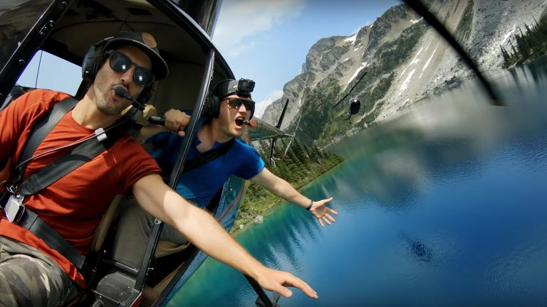 Best GoPro 2019: two men in a helicopter film themselves flying over a lake
