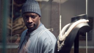 """Omar Sy (as the character Luis Perenna) eyes the Queen's Necklace in the Netflix series """"Lupin."""""""