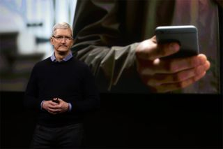 Apple CEO Tim Cook presenting an iPhone.